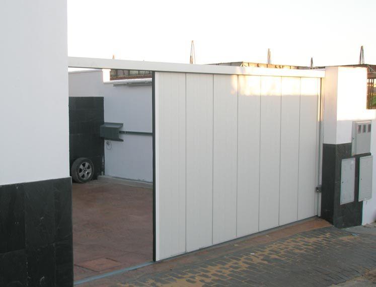 Puertas seccionales laterales puertas de garaje - Motores puertas automaticas precios ...